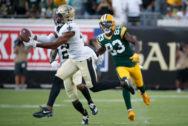 New Orleans Saints free safety Marcus Williams, left, intercepts a pass in front of Green Bay Packers wide receiver Marquez Valdes-Scantling (83) during the second half of an NFL football game, Sunday, Sept. 12, 2021, in Jacksonville, Fla. (AP Photo/Stephen B. Morton) ORG XMIT: JVS124