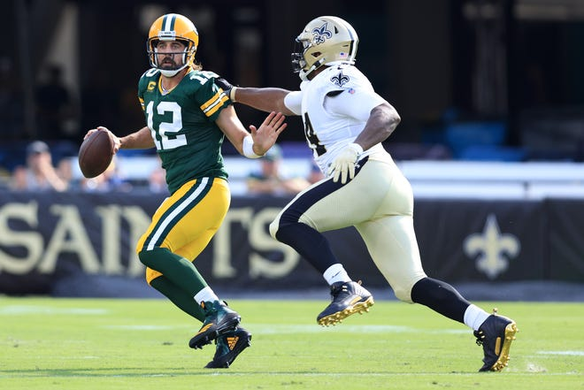 Green Bay Packers quarterback Aaron Rodgers gets pressure from New Orleans Saints' Cameron Jordan during the first half Sunday, Sept. 12, 2021 at TIAA Bank Field in Jacksonville, Florida.