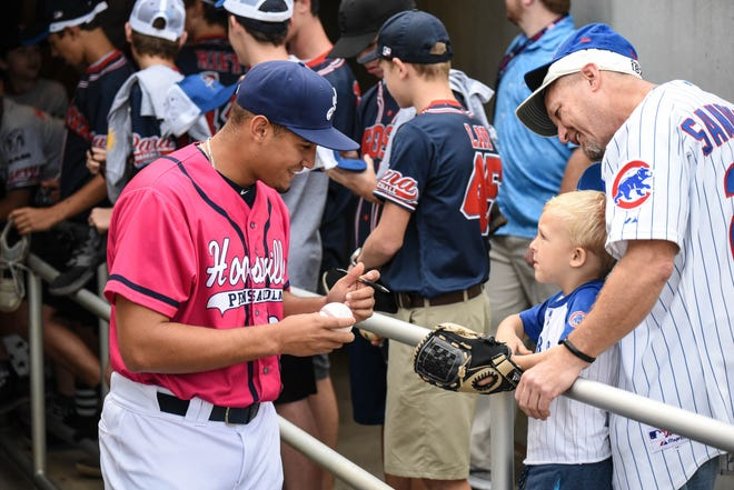 Former Blue Wahoos pitcher Jovani Moran, who became the 100th player in club history to make his MLB debut, signs autographs in 2019 at Blue Wahoos Stadium.
