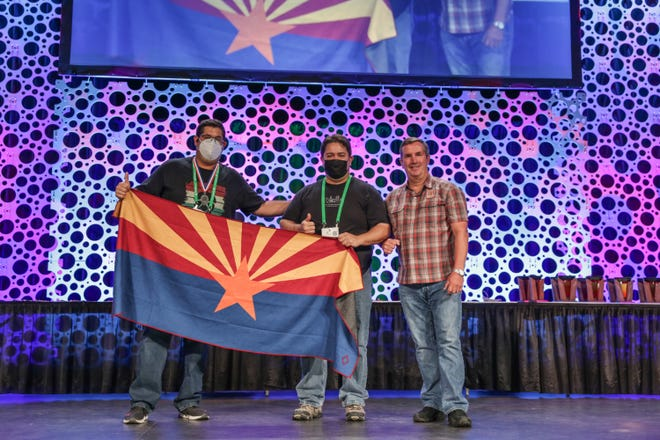 The team at Desert Monks Brewing Co. located in Gilbert accept their silver medal in the Pumpkin Beer category at the awards ceremony in Denver on Sept. 10, 2021.