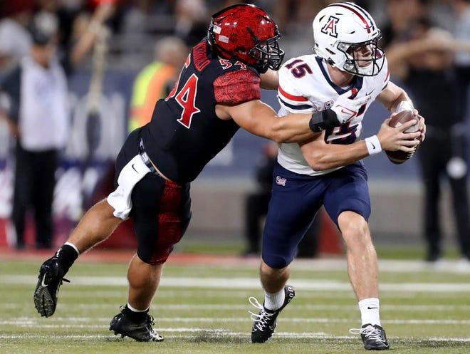 San Diego State linebacker Caden McDonald (54) sacks Arizona quarterback Will Plummer (15) in the third quarter of the Wildcats home opener at Arizona Stadium, Tucson, Ariz., September 11, 2021.