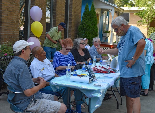 The Friends of Ida Rupp Public Library invited local authors to their 45th anniversary celebration as a way to promote reading at the event. The authors are shown here, seated left to right: Richard Norgard, Dr. Harold Brown, Dr. Marsha Bordner, Donna Lueke and Patrick Lawrence O'Keeffe.