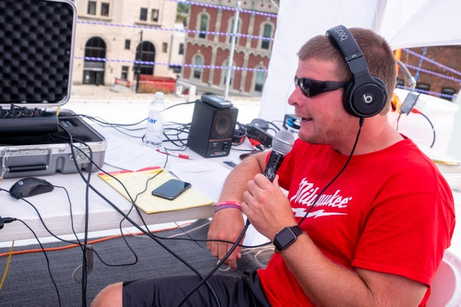 Q Country 107 WSAQ host Matt Markham broadcasts live from the roof of the Michigan Mutual building during the Community Roof-Sit for Kids' Rooftop Rally Tuesday, Sept. 17, 2019, in downtown Port Huron.