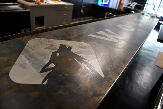 The logo for Stihl Wolf is shown on the bar of the new business Monday, Sept. 13, 2021, in St. Cloud.