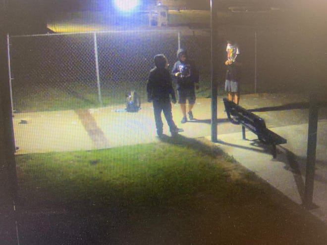 Security surveillance captured this image of three suspected vandals who caused such heavy vandalism that John Tower Elementary School had to cancel classes Monday.