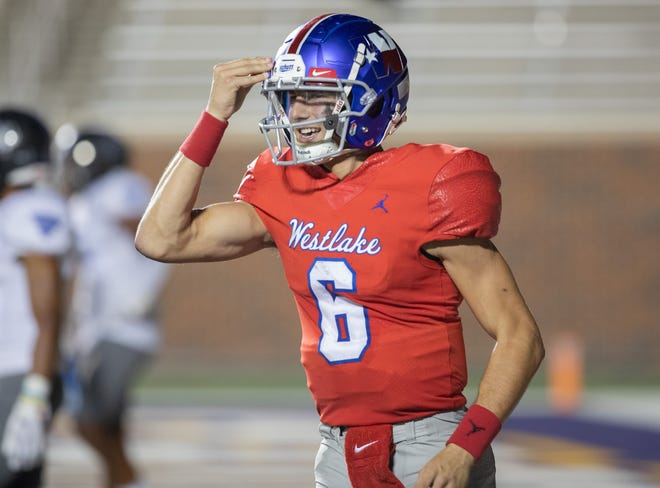 Westlake quarterback Cade Klubnik, motioning during the Chaps' win over Mansfield Summit Friday, threw for six touchdowns as he completed 23 of 30 passes for 375 yards in the win.