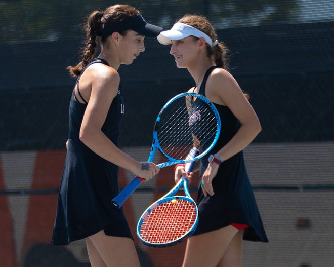 Jacqueline Creel, right, and Julia Creel helped the Lake Travis tennis team defeat Round Rock before falling to No. 2 Westwood. The Cavs return to action this week against Bowie.