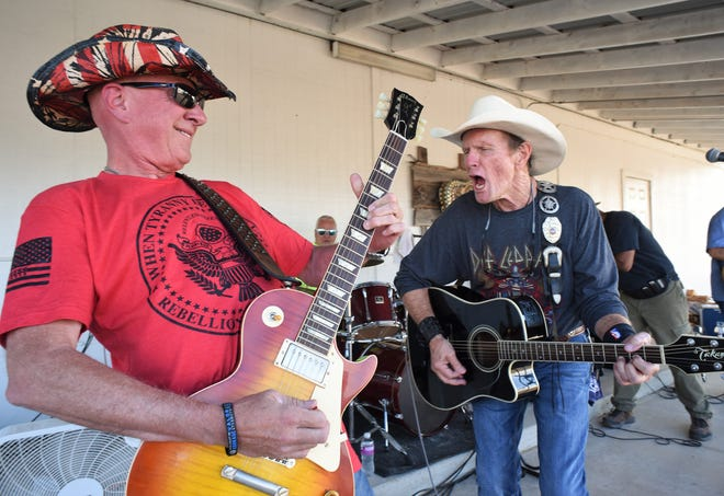 """Guitarist Robert """"Robbie"""" Dougherty, left, and Tommy Schaper, founder and singer with the Shop Dawgz, play a scorching rock 'n' roll song at SlaterFest on Saturday."""