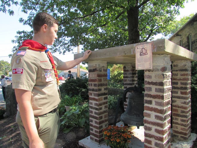 Emmett Geul explains how be brought over the Old School bell and coordinated the effort to re-create the bell shelter for his Eagle Award project. The bell can be seen outside the Twinsburg Historical Society.