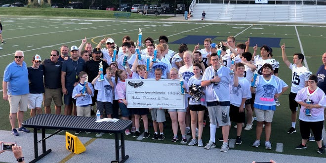 Hudson Hawks present a check for $13,000 to Hudson Special Olympics at the Annual Challenger Football Classic. on Sept. 7.