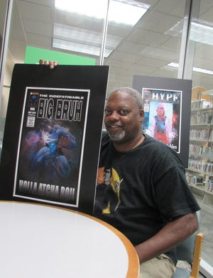 Keith Harris of Twinsburg Township holds up art of Big Bruh, his central character in a comic book series FutureGen Comics will publish later this year. A graphic reference book was published in August.