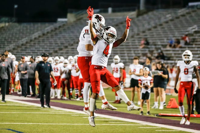Melissa Cardinals wide receiver Jayvon Smith (4) celebrates with quarterback Sam Fennegan (11) after scoring a touchdown during the Melissa Cardinals vs Carter Cowboys high school football game at John Kincaide Stadium in Dallas, Texas on September 10, 2021. (Photo by Matt Pearce/Buzz Photos)