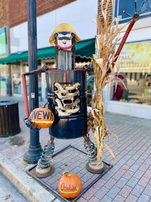 """This scarecrow designed by One Way Automotive won the special creativity award last year. This year's creativity award willer will receive $250 """"Scarecrow Dollars"""" to spend at participating local businesses."""
