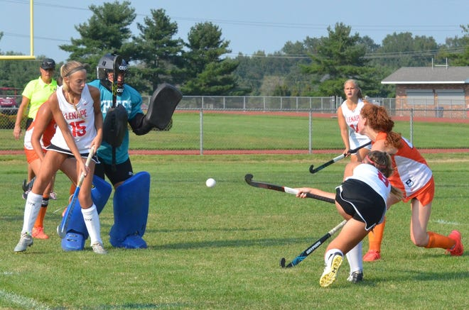Cherokee senior goalie Sarah Crysler is shielded by Lenape's Bryn Iuliano as Brooke Halfpenney fires a rebound at her