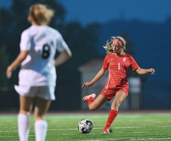 Freedom's Morgan Keller (1) scores the Bulldogs' first goal of the night during a game against Greensburg Central Catholic Monday at Freedom Area High School.