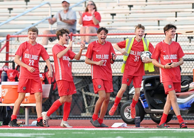 Freedom's starters cheer after freshman Blaine Smith scored a goal during the second half of a game against Ellwood Monday at Freedom Area High School.