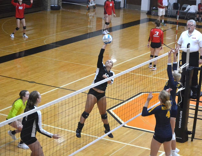 Cheboygan senior Madison Farver, middle, hits a ball over the net during a match against Gaylord at a home invitational on Saturday, Sept. 11.