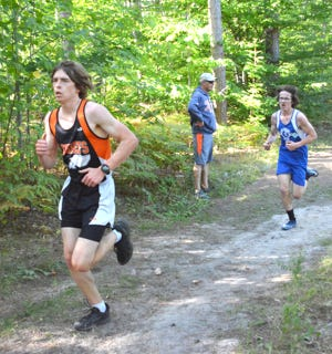 Cheboygan's Luke Patrick, left, finished in eighth place in the boys race at the first Straits Area Conference meet at Newberry on Monday.