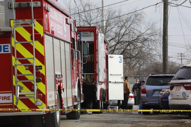 A Columbus Division of Fire heavy rescue truck was among the vehicles on the scene at a home in the 2400 block of Sullivant Avenue on January 13, 2021, where the remains of a man and woman were found buried in concrete in the basement.