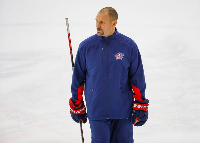 Head coach Brad Larsen watches his players during the Columbus Blue Jackets development camp at the OhioHealth Ice Haus in Columbus on Tuesday, Sept. 14, 2021.