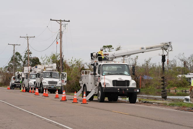 Crews work to repair Entergy power lines earlier this week in Chauvin and Montegut.