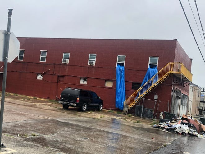 The Bunkhouse at 8424 Main St. in Houma, which provides shelter for homeless single men, sustained flood damage from Tuesday's rains despite receiving a tarp last week.