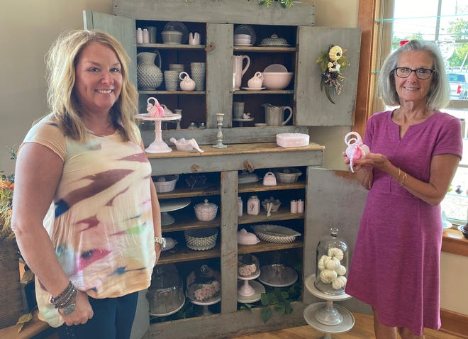 Mindy (Mosser) Hartley, left, and Sally Johnson of Mosser Glass stand with some of the 200 pink pumpkins that will be sold beginning Oct. 1 as a fundraiser for the Cancer Center at Southeastern Med. The pumpkins are $40 apiece and will be on sale until they are gone.