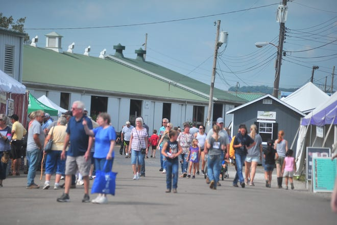 A sunny Tuesday at the fair brings in a big crowd.