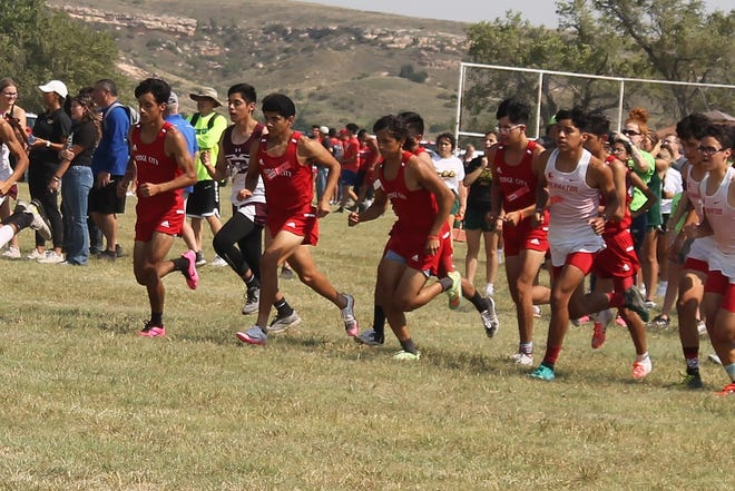 Dodge City High School cross country team compete in first 5K of the season.