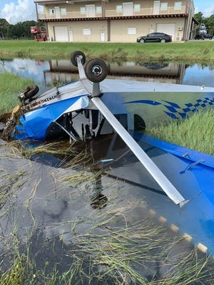 Officials said this single-engine, two-seater experimental plane crashed at an airport in Edgewater on Tuesday. The two people onboard the aircraft escaped injury.