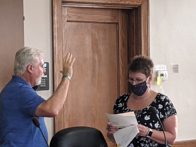 Brad Ovial was appointed Monday to fill a vacant term on Ellwood City Council, left by the recent resignation of Lisa Guerrera, which will expire on Dec. 31. Ovial is a former council member. Pictured is Ovial being sworn into office by borough Secretary Linda List.