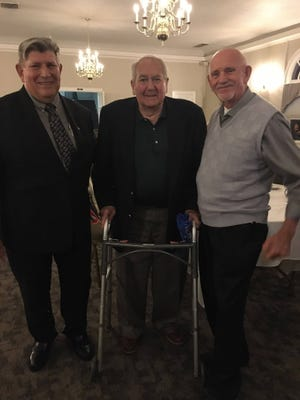 The Ellwood City Area Historical Society held a Champions on Parade banquet that celebrated sports icons from the area. The guest speaker was former Ledger reporter Marino Parascenzo (center). Pictured is Parascenzo with society President Everett Bleakney Jr. (right) and society Second Vice President Robert Morabito, who served as emcee of the event.