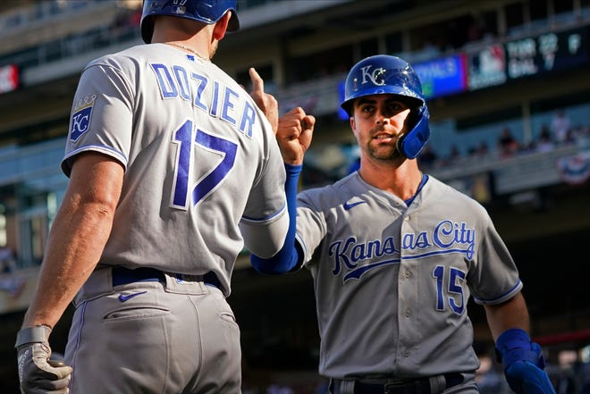 Kansas City Royals Whit Merrifield (15) fist-bumps Hunter Dozier after Merrifield scored on a Andrew Benintendi sacrifice fly off Minnesota Twins pitcher Juan Minaya in the ninth inning of a baseball game on Sunday in Minneapolis. The Royals have shown more promise in the second half of this season as fans hope for a return to the success of recent years.