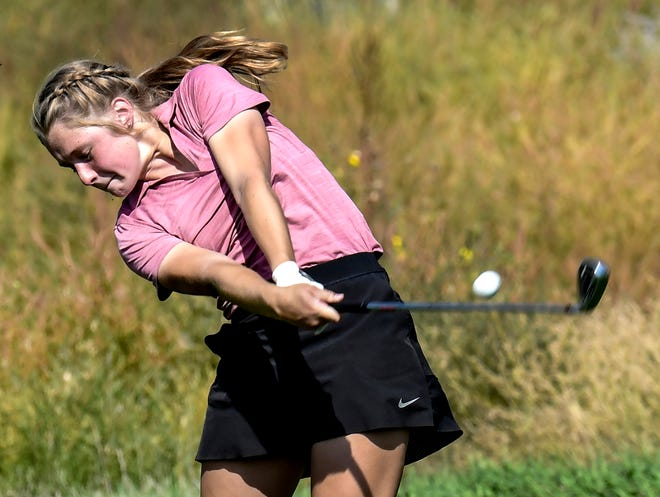 Garden City High School's Ryann Warren hits a tee shot off Buffalo Dunes golf course's No. 13 during the 2020 GCHS girls golf invite. Warren finished in fourth place Monday at Liberal.