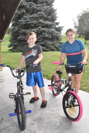 Winners of the bike drawing at Orion Lions Club's Bike/Hike4Sight on Saturday morning, Sept. 4, are Jameson Graff, left, and Libby Jones. The fundraiser at Love Park was part of Orion Fall Festival.