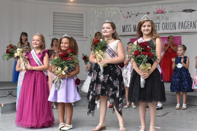 Royalty selected at the Miss Main Street Orion pageant are, from left, Little Miss first runner-up Myla Purdy, Little Miss Elaina Morgan, Junior Miss first runner-up Olivia Page and Junior Miss Kendall Kosowski. The pageant was during Orion Fall Festival on Saturday, Sept. 4, at the band shell in Central Park.