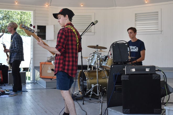 Strictly Business was the first band from the QC Rock Academy to perform during Rock the Park at Orion Fall Festival on Sunday, Sept. 5, in the band shell at Central Park.