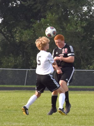 Orion-Sherrard's Ben Churchill, right, collides with Kewanee's Jack Coombes during the match on Tuesday, Sept. 7, at Sherrard