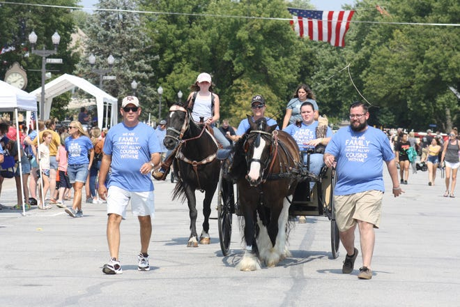 The Finnell Family entry, driven by Jackie Rollins and pulled by Sir Thomas the Black Gypsy Vanner, concluded this year's Big Parade.