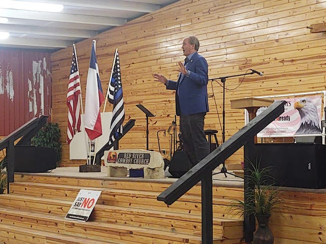 Texas Attorney General Ken Paxton speaks at Red River Cowboy Church during a Texoma Patriots meeting Monday.