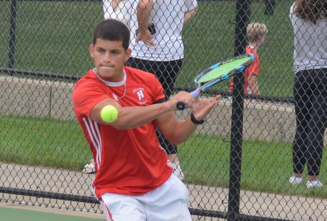 Holland tennis player Cristian Castro-Gonzalez returns a shot.
