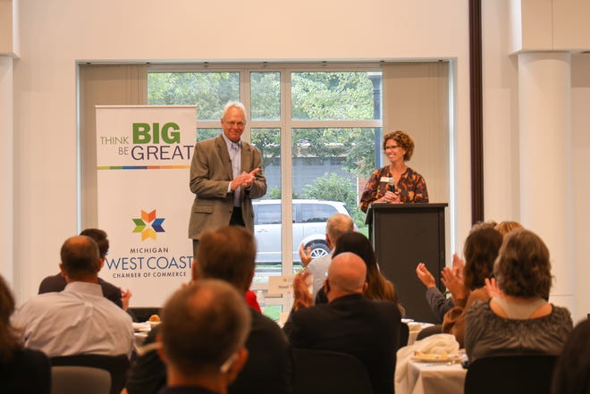 Jane Clark, president of the West Coast Chamber of Commerce, shares the stage with Rich Sheridan, CEO of Menlo Innovations of Ann Arbor. Sheridan spoke at Wake Up West Coast on Tuesday, Sept. 14. It was the first in-person event for the chamber since March 2020.
