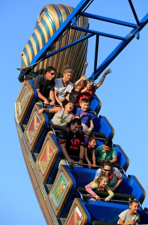 Many different expressions can be seen on the people riding the Pharaoh's Fury on the midway at the Kansas State Fair Monday evening, Sept. 13, 2021.