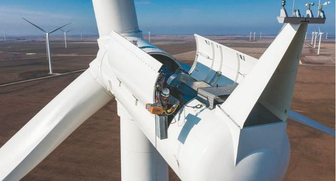 Garrett Smith of Pratt lifts tool bags into the nacelle of a Siemens Gamesa 2.3 megawatt wind turbine in the Pratt Wind Energy Center, which came online in 2019.