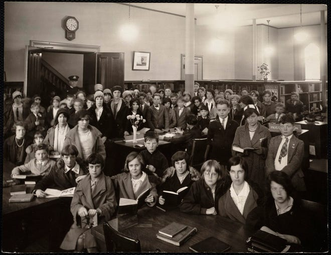 This photo from the 1920s shows school kids in the children's room at the Dorchester branch of the Boston Public Library.