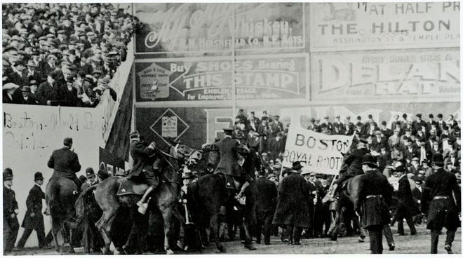 Boston Mounted Police try to control fans outside the left field wall at Fenway Park during the 1912 World Series. Temporary stands were constructed for big games on the grass incline in front of the wall. The incline was named Duffy's Cliff because of Duffy Lewis's skill at playing on the incline. Learn more at www.digitalcommonwealth.org.