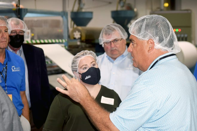 Jeff Chalabi, right, leads a tour Tuesday through Central Bag Company in Leavenworth. The event was part of the 2021 Making Kansas Bus Tour. The Making Kansas Bus Tour is organized by the Kansas Manufacturing Council in partnership with Kansas Manufacturing Solutions and the Kansas Chamber of Commerce. The goal of the tour is to raise awareness about manufacturing in Kansas, the products made in the state and career opportunities in the industry. Chalabi is the president of Central Bag Company. Participants of the bus tour made two additional stops in Leavenworth – Zephyr Products and Great Western Manufacturing.