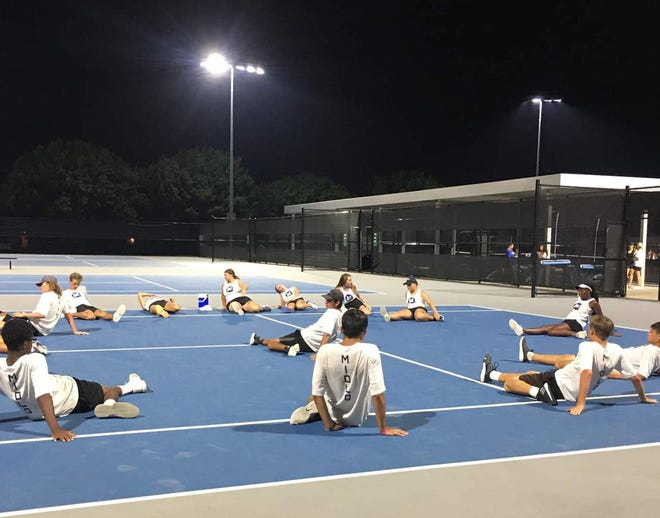 The Midlothian tennis team stretches out following a match against Corsicana last Tuesday, Sept. 7.