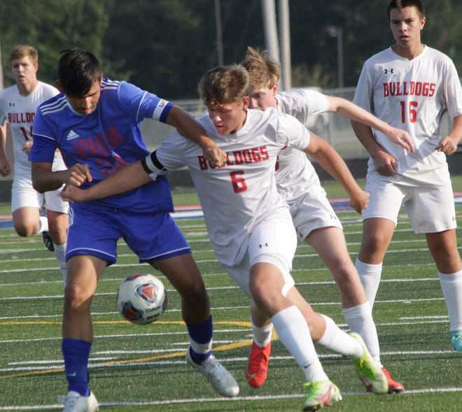 Moberly Spartans senior forward Chris Coonce (left) battles a Mexico player for ball possession Monday during a home conference game played at Dr. Larry K. Noel Spartan Stadium. Coonce netted three goals to help Moberly win 8-0.