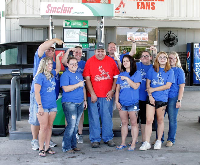 Dino Mart & Dinowash of Moberly owner Rob Gillenwater and his employees held a surprise celebration on Sept. 10, 2021 in honor of Kevin Embree for his 35 years of service at this same gasoline convenience store location at 1634 State Hwy JJ. Embree arguably may hold a world record for being a full service gas attendant at the same business for more than three decades. Many of his customers were told in advance to stop by for a visit and receive a free hot dog lunch between 10 a.m. and 2 p.m. that Friday. Dino Mart employees shown are (first row) Keri Benner, Amanda Gunn, Kevin Embree (red shirt), Jerri Oliver and Lillie Harville. (Second row) Van Benner, Jess Spotts, Dino Mart owner Rob Gillenwater, Nickie Little and Erin Little.